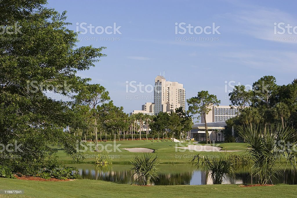 Scenic view of a resort golf course with hotel background stock photo