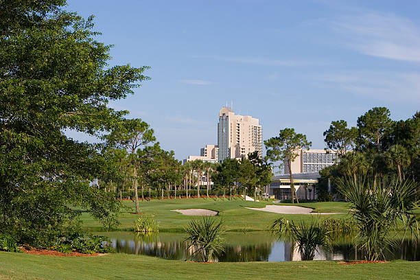 scenic view of a resort golf course with hotel background - kissimmee stock photos and pictures