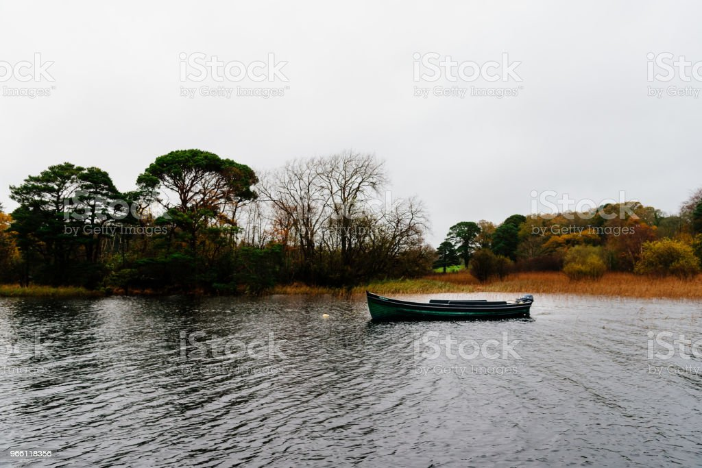 Scenic view of boat in lake in Killarney a misty day - Royalty-free Autumn Stock Photo