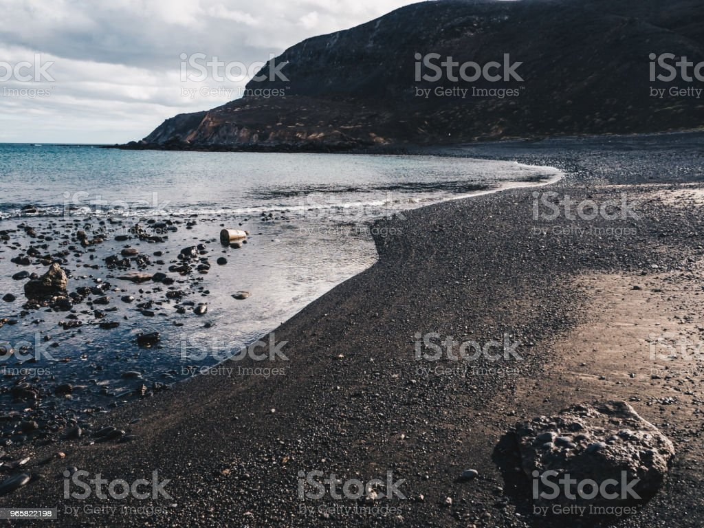 Scenic view of calm ocean and black sand beach of Ajuy in Fuerteventura, Canary Islands, Spain. Dark clouds - Royalty-free Atlantic Ocean Stock Photo