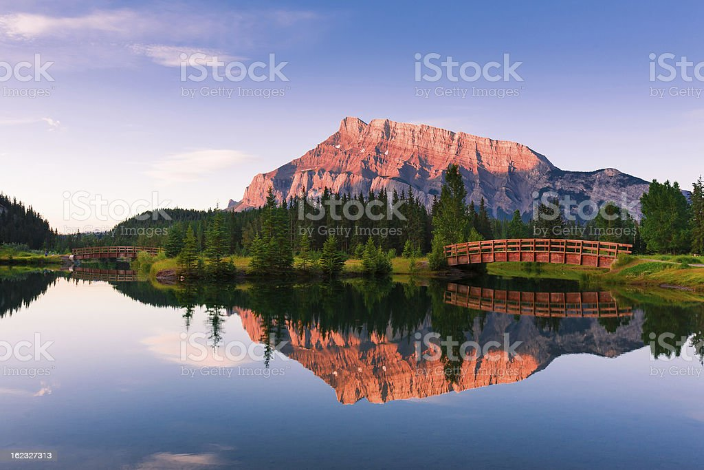 A scenic view of Cascade Ponds with a reflective sunset stock photo