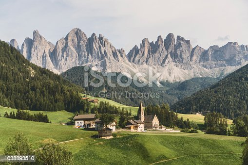 Scenic view of church St.Johann in Ranui in Val di Funes in Dolomites Alps, Italy
