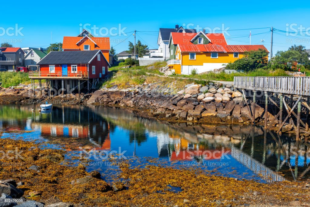 Scenic view of Colorful wooden buildings in Henningsvaer in summer. stock photo