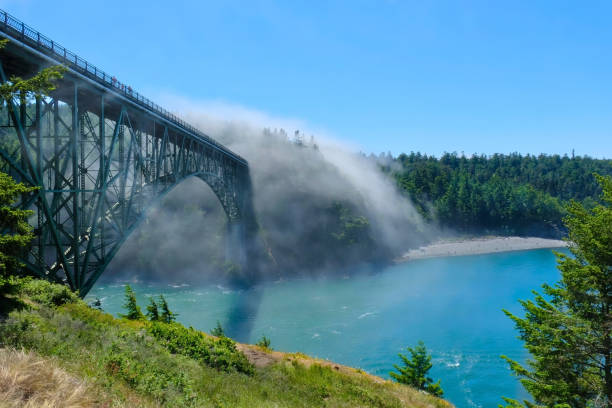 Scenic view of  Deception Pass Bridge in fog. stock photo