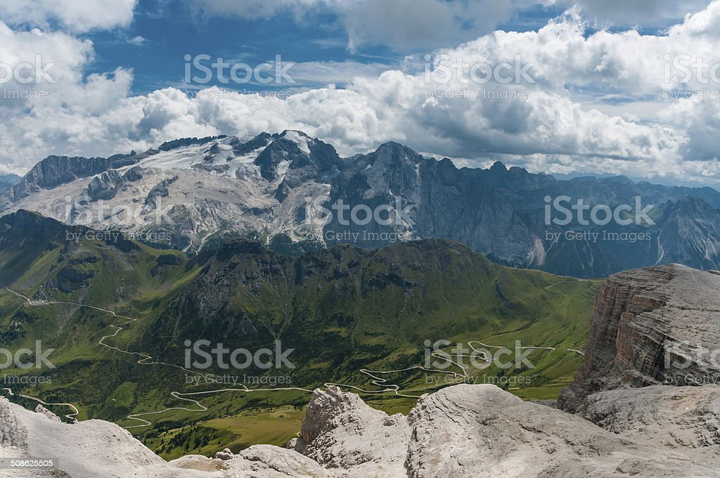 Scenic view of Dolomites mountains with dramatic clouds. stock photo