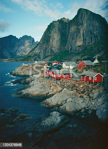 Scenic view of fishing village with red houses in Lofoten Islands, Norway