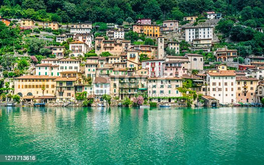 Scenic view of Gandria colorful fishing village houses on the shore of Lake Lugano on beautiful summer day in Lugano Ticino Switzerland