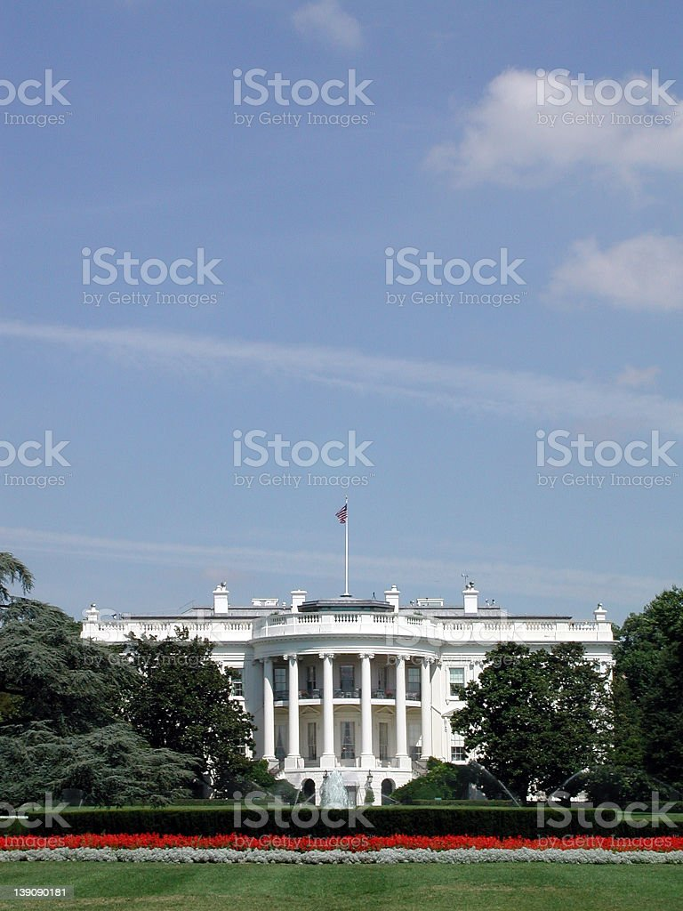 Scenic view of he White House and lawn under blue sky royalty-free stock photo