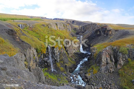 Scenic view of Hengifossargljufur gorge in Fljotsdalur valley. Scenic landscape near the trail leading to the Litlanesfoss and Hengifoss waterfalls.