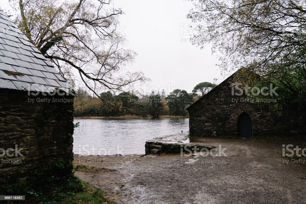 Scenic view of house in forest by lake - Royalty-free Abandoned Stock Photo