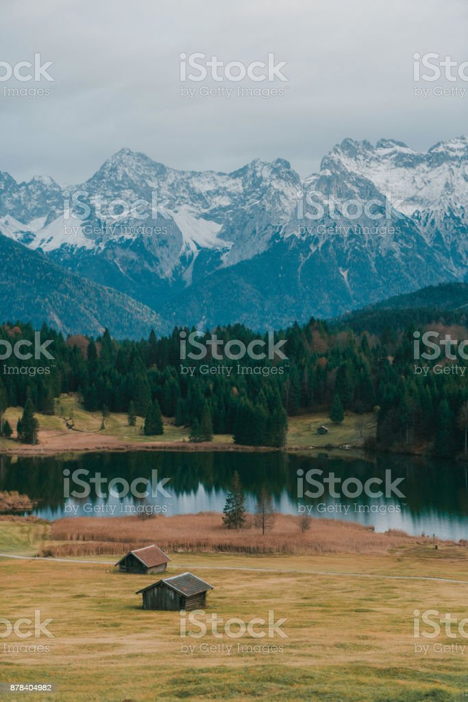 Scenic view of huts near the Gerold lake in Alps stock photo