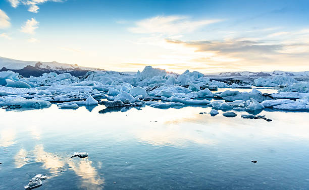 Scenic view of icebergs in glacier lagoon, Iceland Beautiful view of icebergs in Jokulsarlon glacier lagoon at sunset, Iceland;  selective focus jokulsarlon stock pictures, royalty-free photos & images