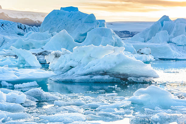 Scenic view of icebergs in glacier lagoon, Iceland Beautiful view of icebergs in Jokulsarlon glacier lagoon, Iceland;  selective focus jokulsarlon stock pictures, royalty-free photos & images