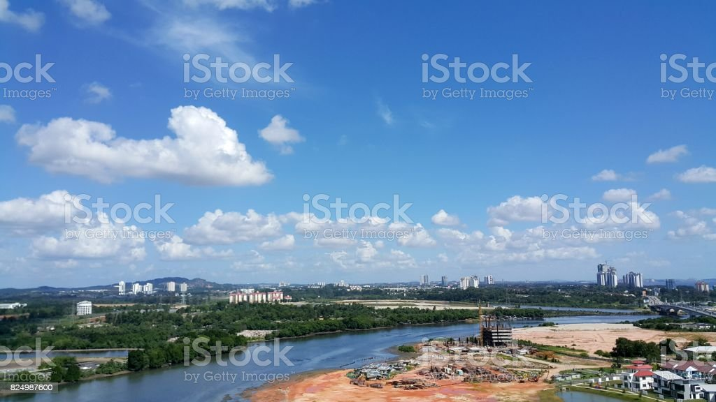 Scenic view of Johor Bahru cityscape with river view on sunny day with blue sky stock photo