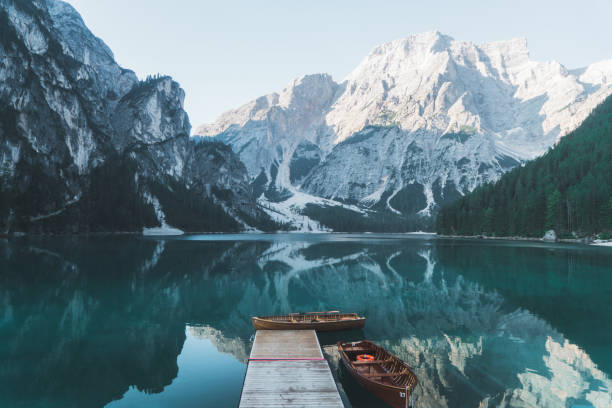 Scenic view of Lago di Braies  in Dolomites Scenic view of boats on Lago di Braies lake   in Dolomites lake stock pictures, royalty-free photos & images