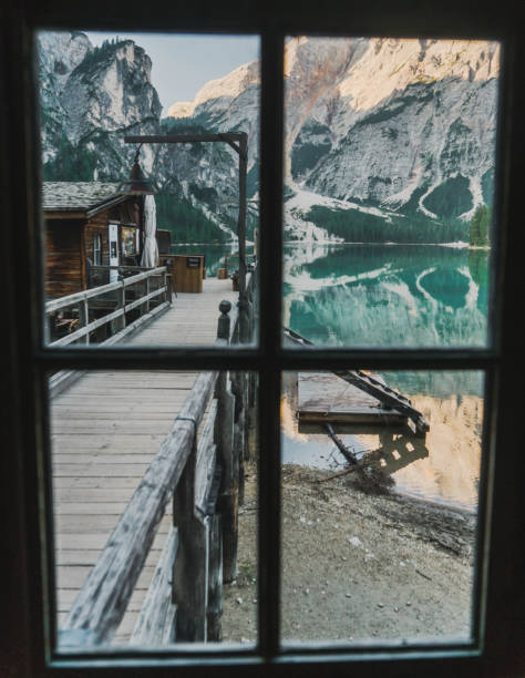scenic view of lago di braies through the window  in dolomites - latemar foto e immagini stock