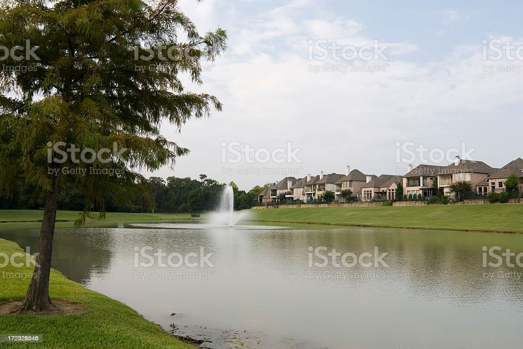 Scenic view of lake with village nearby stock photo