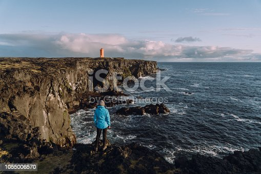 Scenic view of orange  lighthouse  in Iceland