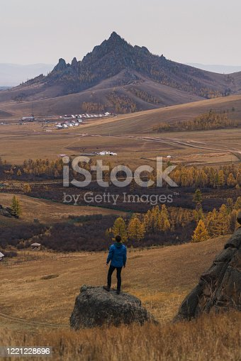 Scenic view of man on the background of mountain in Mongolia