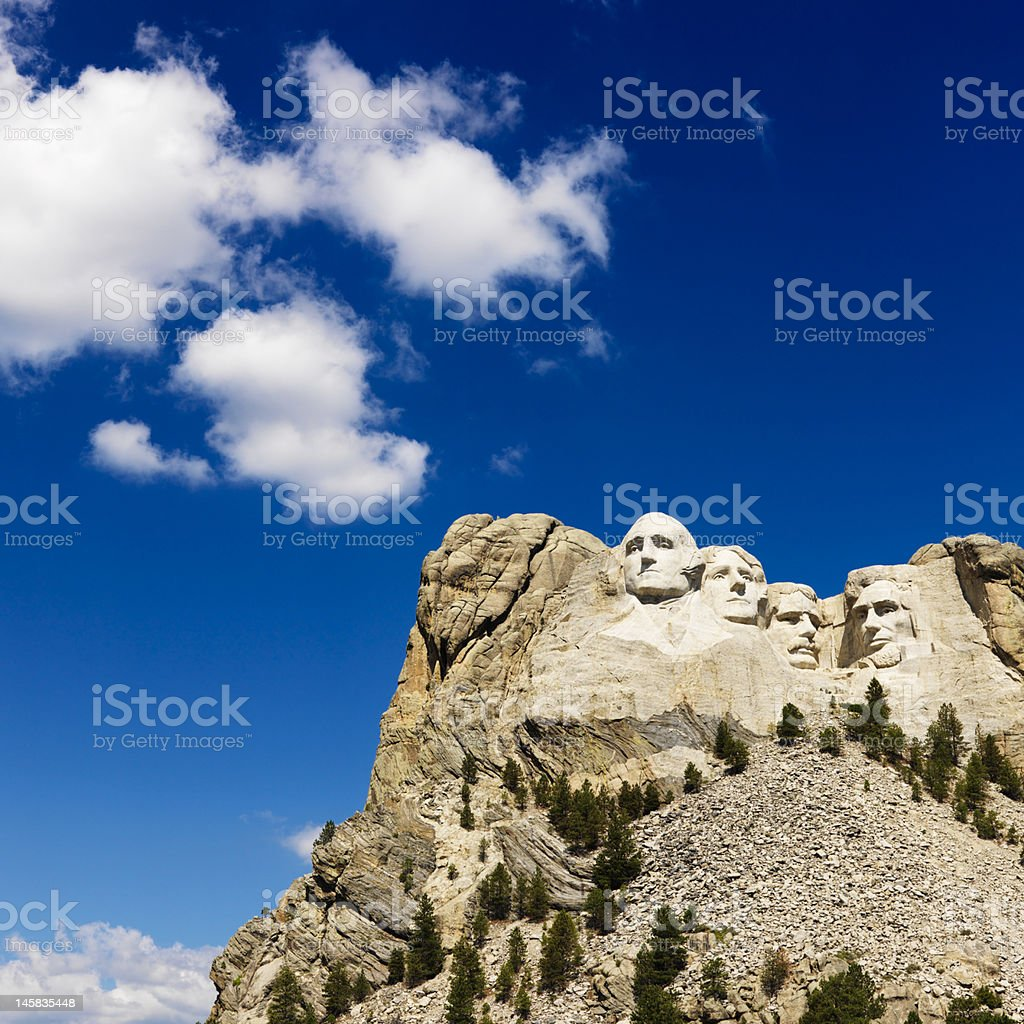 Scenic view of Mount Rushmore against bright blue sky stock photo