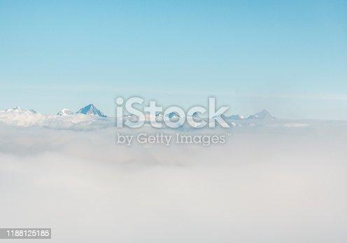 Mountain peak covered in thik fog in Saas-Fee, Switzerland.