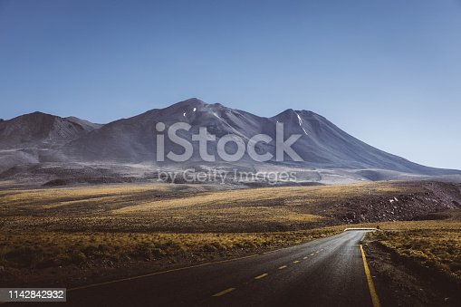 View of mountain road and volcanic colorful landscape in Atacama region, Chile