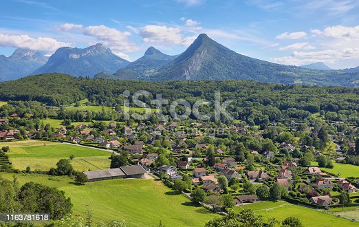 istock Scenic view of mountains and scattering houses from Menthon castle in Haute-Savoie 1163781618