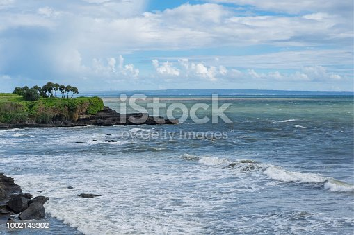 istock scenic view of ocean waves and cloudy blue sky in ubud, bali, indonesia 1002143302