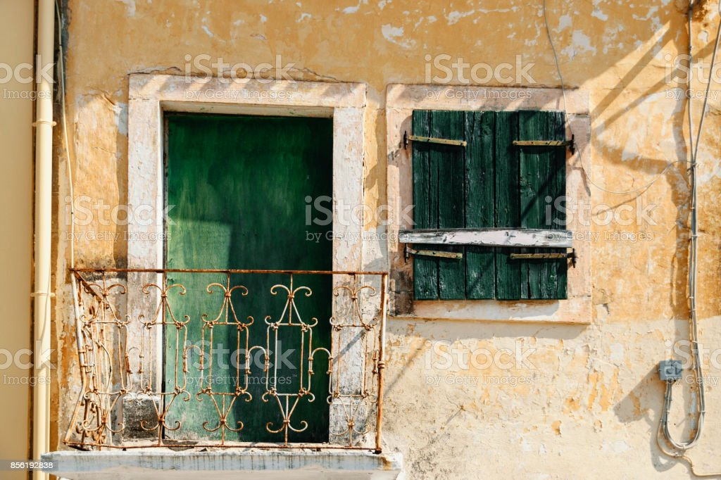 Scenic View Of Old Traditional Greek Balcony With Green Wooden Window And Door stock photo