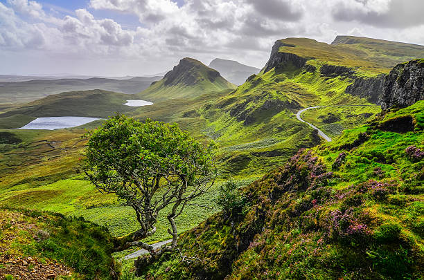 Scenic view of Quiraing mountains in Isle Skye, Scottish highlands Scenic view of Quiraing mountains in Isle of Skye, Scottish highlands, United Kingdom isle of skye stock pictures, royalty-free photos & images