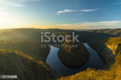 Scenic view of river in forest in Czech Republic  at sunset