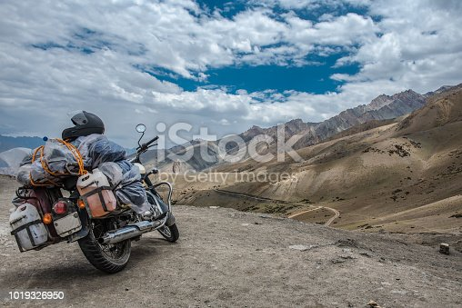 Scenic view of road by landscape with mountain, road and blue sky seen through motor bike, Leh is a town in the Leh district of the Indian state of Jammu and Kashmir.
