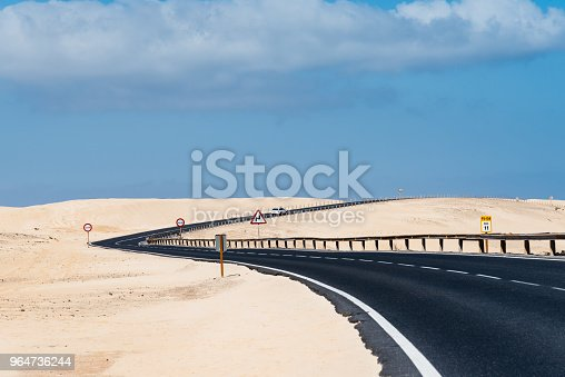 Scenic View Of Road Through Sand Dunes Against Sky Stock Photo & More Pictures of Atlantic Islands