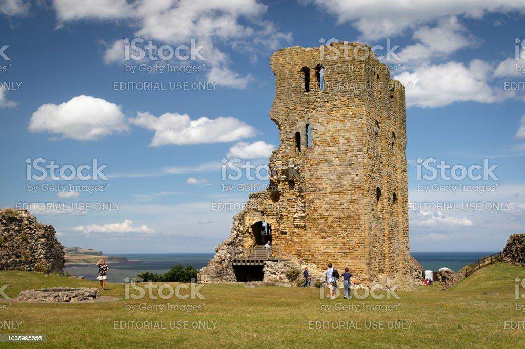 Scenic View Of Ruins Of Scarborough Castle With Blue Sky And