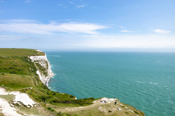 scenic view of sea and cliffs against sky, day light - english channel stock pictures, royalty-free photos & images