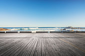 scenic view of seascape against sky,empty wooden plank on foreground.