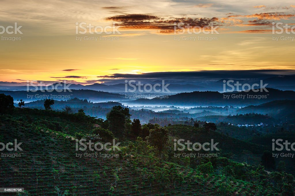 Scenic view of sequences mountains covered with layer fog stock photo