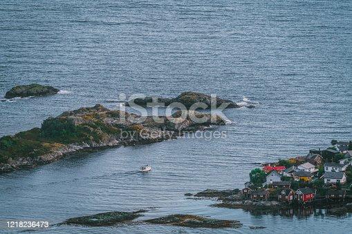Scenic view of ship cruising in fishing village in Lofoten Islands