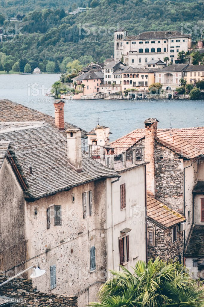 Scenic view of the antique  city San Giulio and the island San Giulio with the old monastery, Lake Orta, Piedmont, Italy royalty-free stock photo