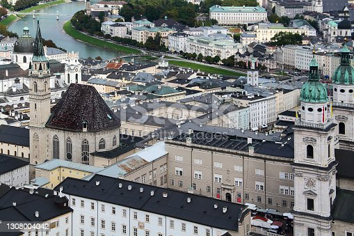 Scenic view of the city of Salsburg from a bird's eye view. In the background is the Danube River