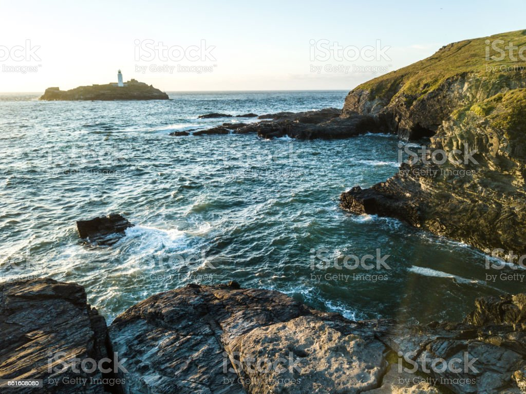 Scenic view of the Godrevy lighthouse at dusk stock photo