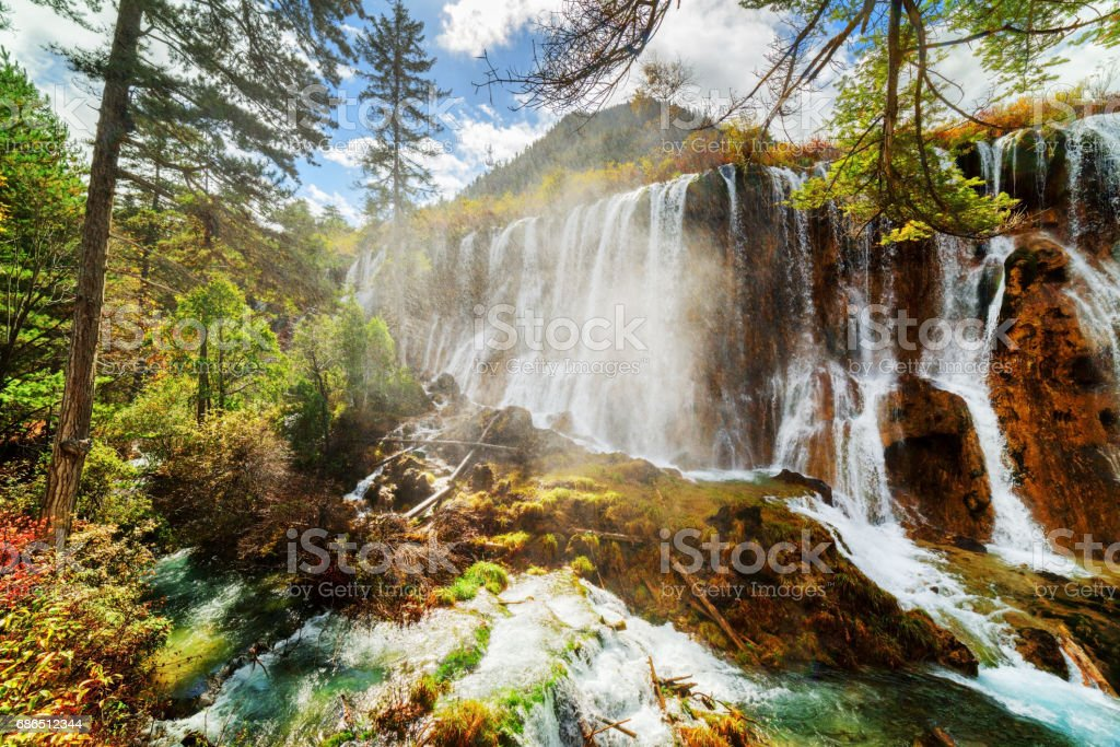 Scenic view of the Nuo Ri Lang Waterfall (Nuorilang) among woods zbiór zdjęć royalty-free