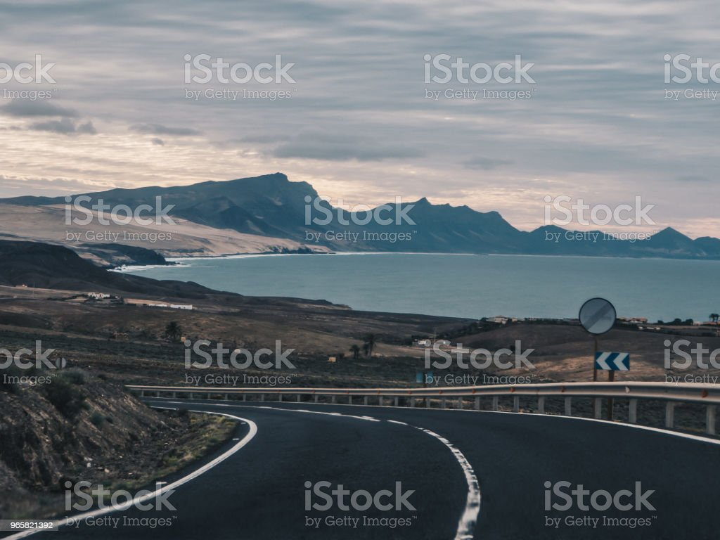 Scenic view of the road near the black beach and ocean in Ajuy in Fuerteventura, Canary Islands, Spain. View from the car - Royalty-free Atlantic Ocean Stock Photo