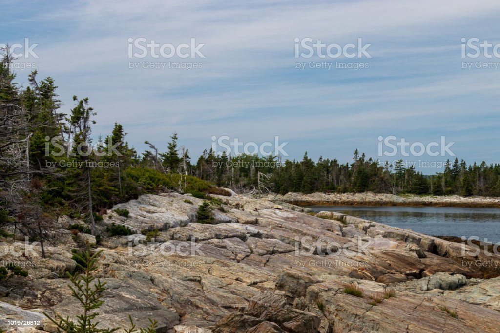Scenic view of the rocky rugged coastline of Middle Island Lunenburg county, Nova Scotia. stock photo