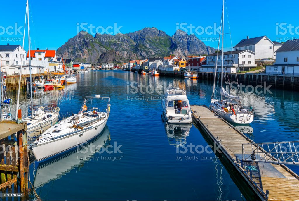 Scenic view of the waterfront harbor in Henningsvaer in summer stock photo
