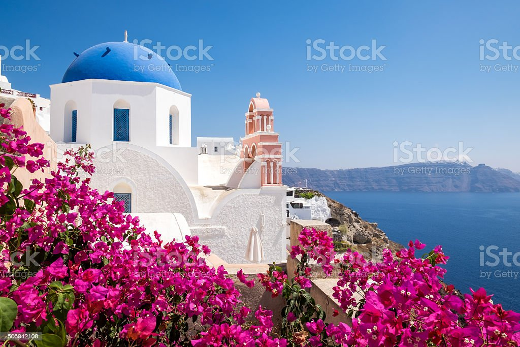 Scenic view of traditional cycladic houses with flowers in foreg stock photo