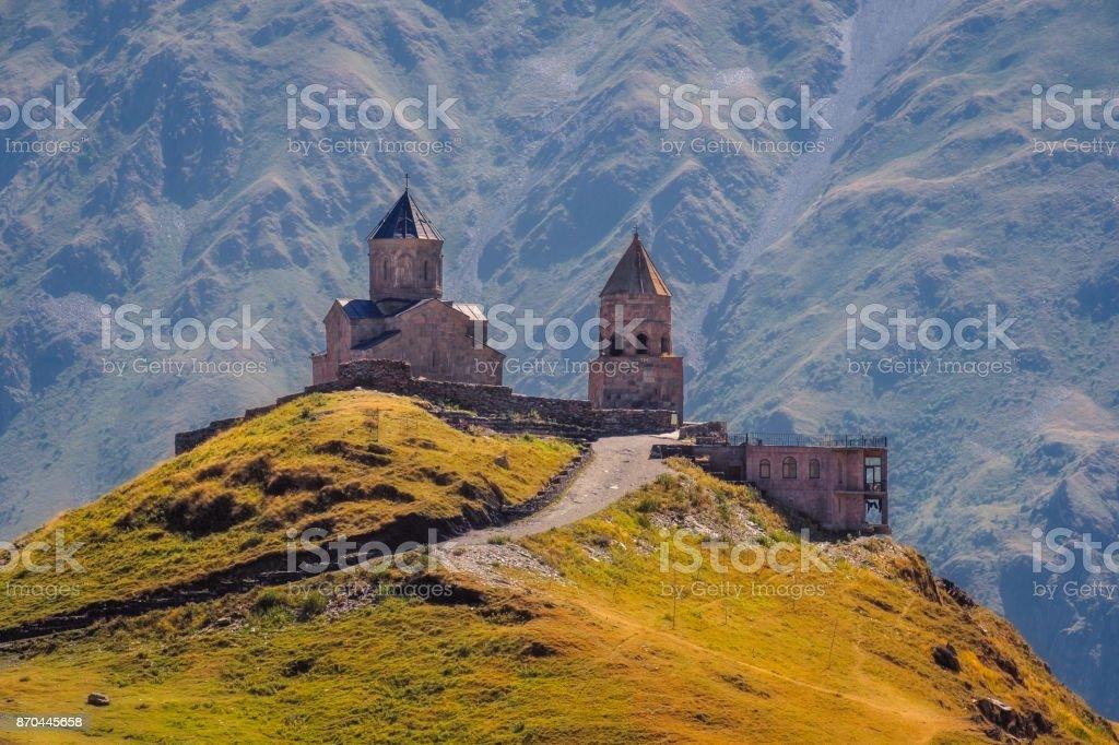 Scenic view of Tsminda Sameba church in Caucasus, Kazbegi, Georgia stock photo