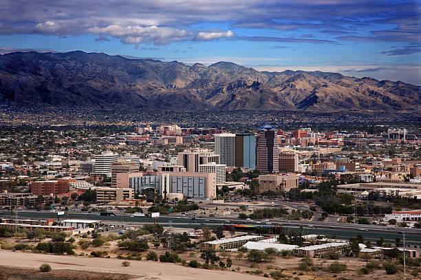 Scenic view of Tucson Arizona with mountains View of the city of Tucson Arizona from the top of Sentinel Mountain tucson stock pictures, royalty-free photos & images