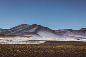 View of colorful mountains and big salt flat in Atacama region, Chile