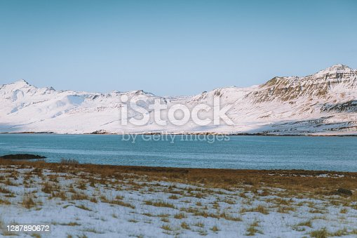Beautiful snowcapped mountains and seashore at East Fjords - Iceland
